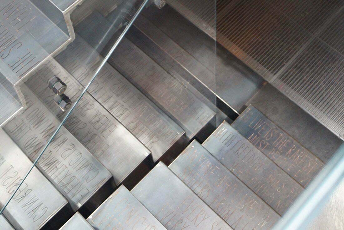 Custom black steel engraved staircase by WETT Solutions.