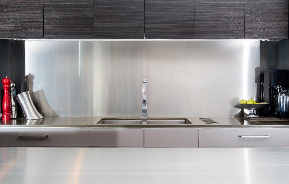 Custom stainless steel splash backs and kitchen benchtops by WETT Solutions, Australia.